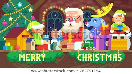 santa helper on green cube stock photo © dolgachov