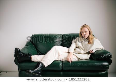 Сток-фото: блондинка · девушки · сидят · черный · диван · великолепный