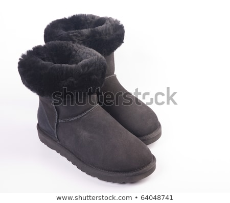 Fluffy woolly warm boots isolated over white Stock photo © shutswis