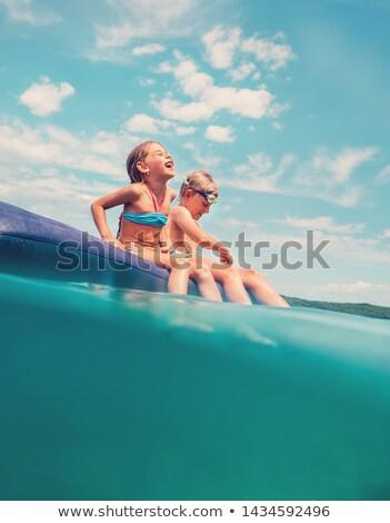 Cute dziewczynka nadmuchiwane materac pływanie garnitur Zdjęcia stock © GekaSkr