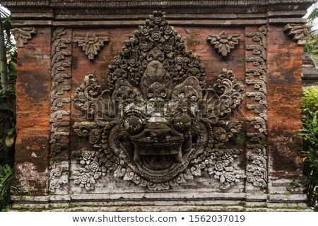 Stone bas-relief on the brick wall. Indonesia, Bali. Stock photo © pzaxe