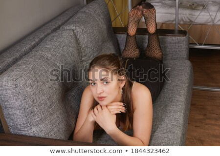woman lying on couch stock photo © elenaphoto