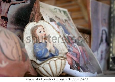 Stock photo: Figurine praying girls