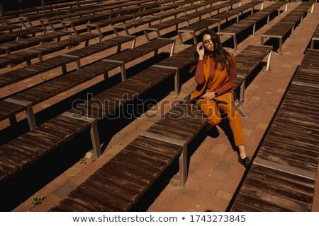 Stílus vörös hajú nő lány ül pad nő Stock fotó © Massonforstock