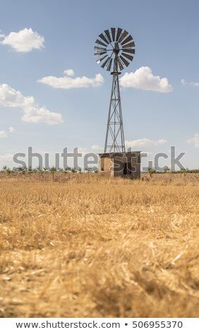 old windmill with cloudy sky stock photo © kyolshin