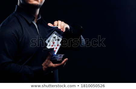 Hands and playing cards trick Stock photo © photosebia