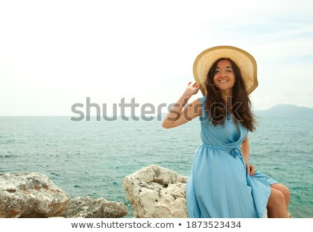 brunette sitting on the stone stock photo © chesterf