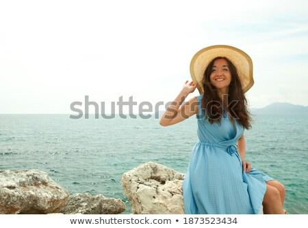 Photo stock: Brunette · séance · pierre · regarder · loin · loin