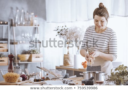 Kadın pişirme mutfak şef sebze kadın Stok fotoğraf © egrafika