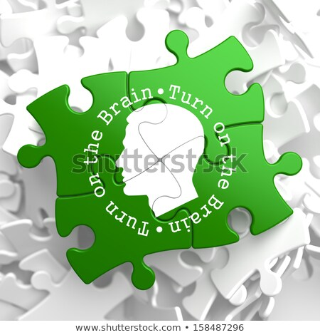 Turn On the Brain:  Green Puzzle Pieces. Stock photo © tashatuvango
