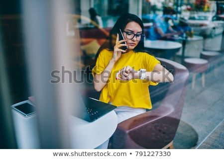 businesswoman with phone and organizer Stock photo © vlad_star