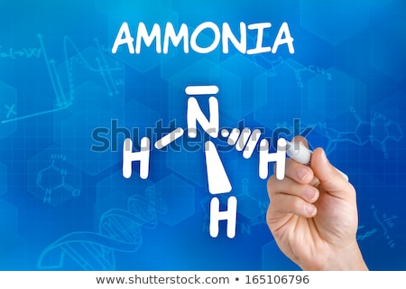 Hand with pen drawing the chemical formula of ammonia Stock photo © Zerbor