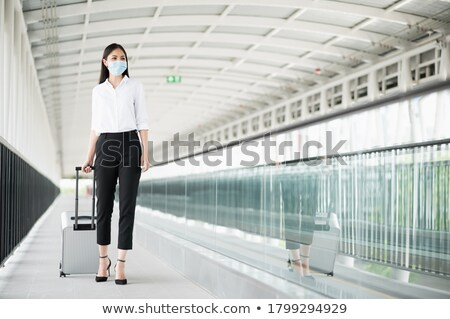 Young businesswoman with trolley Stock photo © ambro