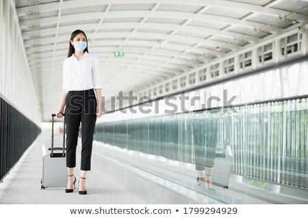 jóvenes · mujer · de · negocios · mujer · trabajo · viaje · empleado - foto stock © ambro