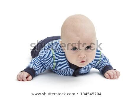 Aandachtig baby leggen grond geïsoleerd witte Stockfoto © gewoldi