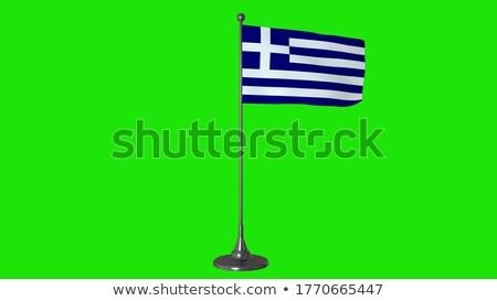 Greece Small Flag on a Map Background. Stock photo © tashatuvango