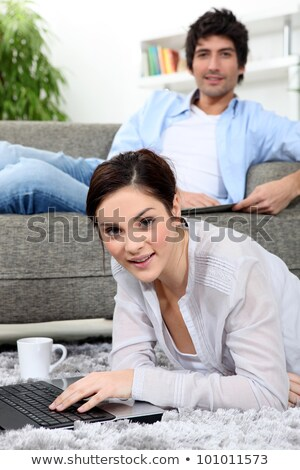 Couple Using Laptop Relaxing Laying On Rug At Home Stock photo © monkey_business
