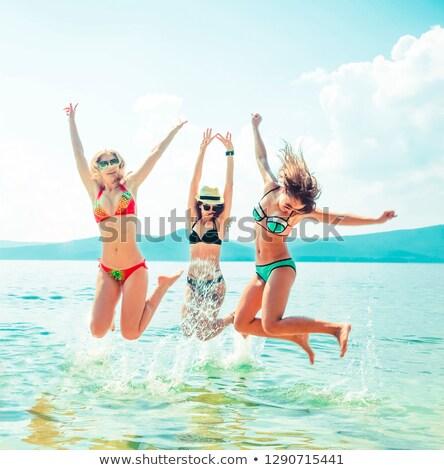 幸せ · 十代の少女 · ジャンプ · ビーチ · 日没 · 時間 - ストックフォト © monkey_business