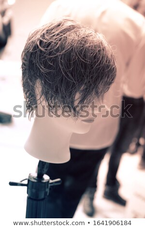 Mannequin head with stylish haircut in hairdressing salon Stock photo © Nejron