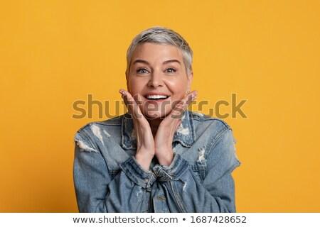 Mulher madura em pé mão queixo mulher preto Foto stock © bmonteny
