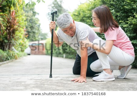 Nurse holding fainting man stock photo © feelphotoart