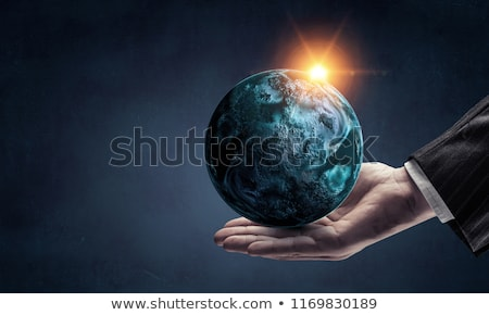 Foto stock: Hands Of God With Earth