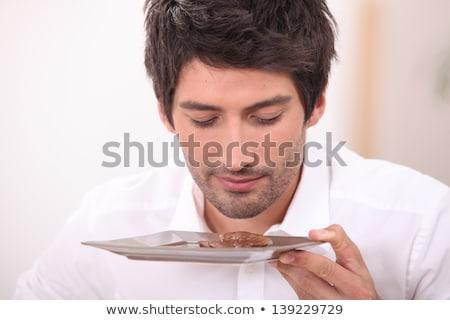 Férfi desszert asztal fiatal mosolyog szoba Stock fotó © feelphotoart