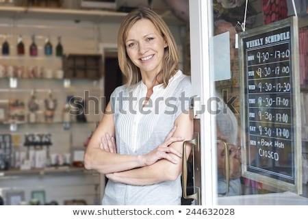 Właściciel dar sklep stałego wejście kobieta Zdjęcia stock © HighwayStarz