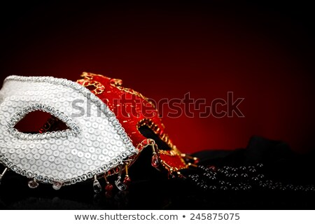 Black peals near carnival masks stock photo © kalozzolak