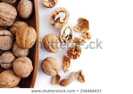 Crude walnut on white background Stock photo © BSANI