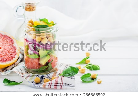 Stock photo: Layer salad in vintage jar