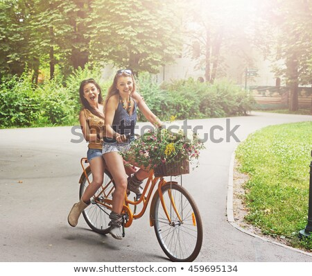 Young stylish woman on a vintage bicycle Stock photo © dariazu