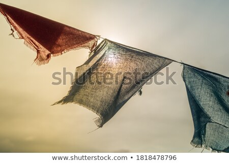 Prayer flags flying in the wind Stock photo © Mariusz_Prusaczyk