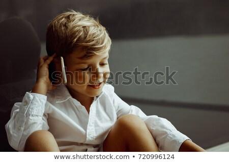 Glimlachend jongen telefoongesprek Stockfoto © stokkete