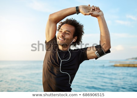 Smiling afro american man running Stock photo © deandrobot