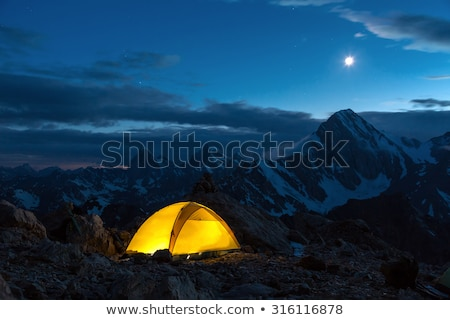 blue illuminated tent at night stock photo © vapi