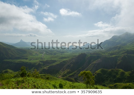 Stock photo: Green valley mountain hill with mist and fog cloud on cape verde island