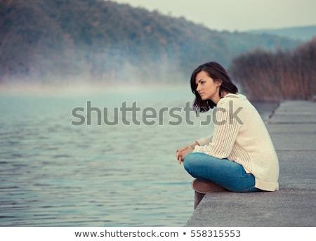 Triest vrouw outdoor winter shot blauwe hemel Stockfoto © jeancliclac