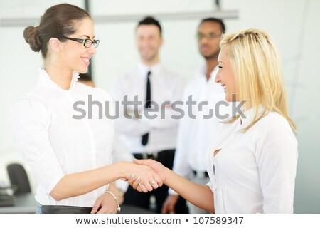 Dois negócio mulheres feminino tratar mão Foto stock © zurijeta