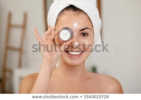женщину веснушки кремом красоту портрет Сток-фото © deandrobot