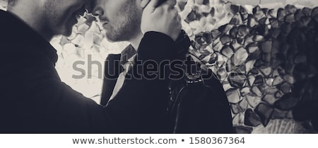 Stock photo: close up of happy male gay couple holding hands