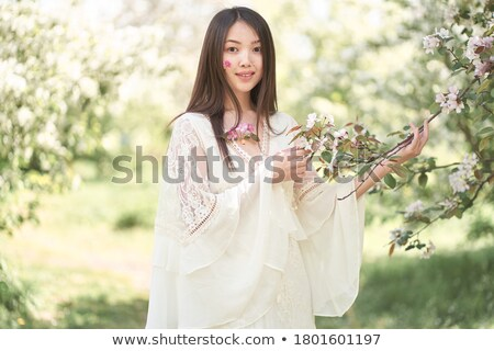 csinos · fiatal · lány · fű · virágok · portré · hosszú · hajú - stock fotó © artfotodima