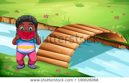 A boy eating watermelon near the wooden bridge Stock photo © bluering