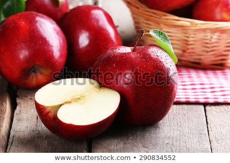 Fresh red apples in wicker basket on wooden table. stock photo © yelenayemchuk