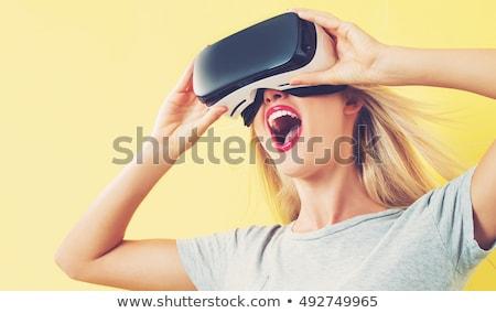 Stok fotoğraf: Blonde Girl Using Vr - Virtual Reality Headset