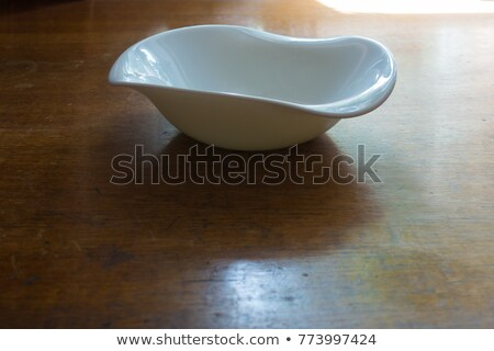 white bowl with irregular rim Stock photo © Digifoodstock