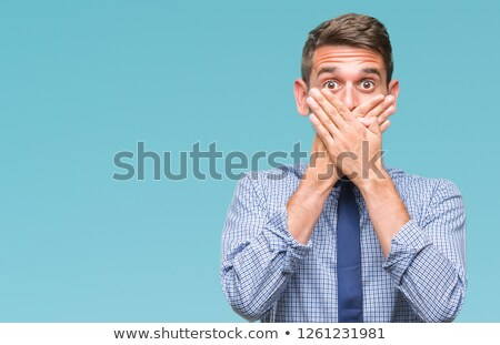 Surprised business man covering mouth Stock photo © deandrobot