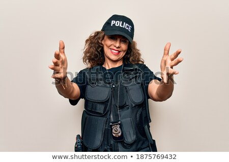 Policewoman with arm out in a welcoming gesture. Stock photo © RAStudio