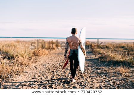 man · surfboard · lopen · wal · strand · water - stockfoto © wavebreak_media