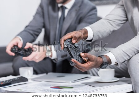 Cropped image of businessman playing video game Stock photo © wavebreak_media